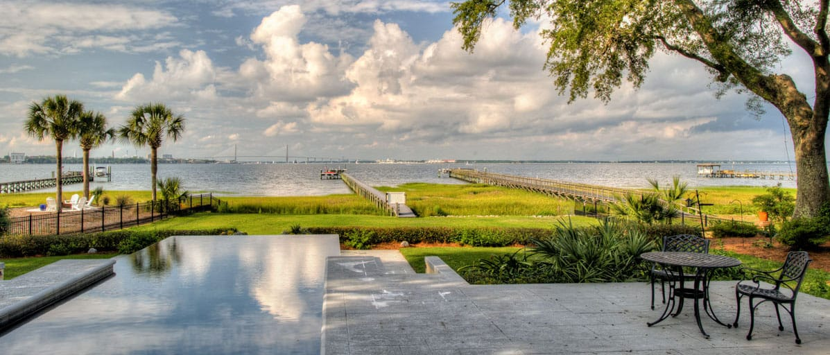 waterfront home backyard with Charleston view