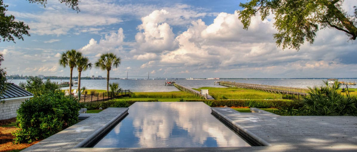 waterfront home infinity edge pool view