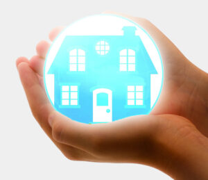 hands cradling globe with home to represent house insurance
